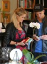 Paris Hilton wears her own line of Handbags